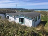 Ridgecote holiday chalet outside sea view